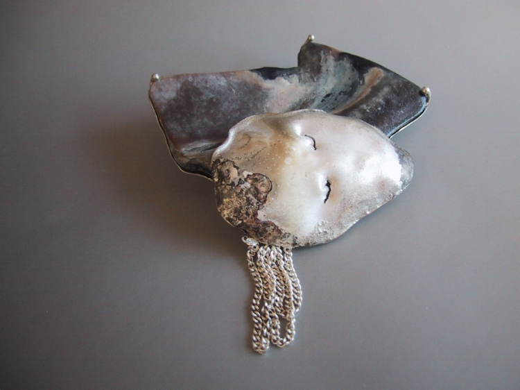Dreaming, brooch    Handformed Sterling silver sheet, wire and chain set with California Mollusk. Fire patinated.   Artist's own collection
