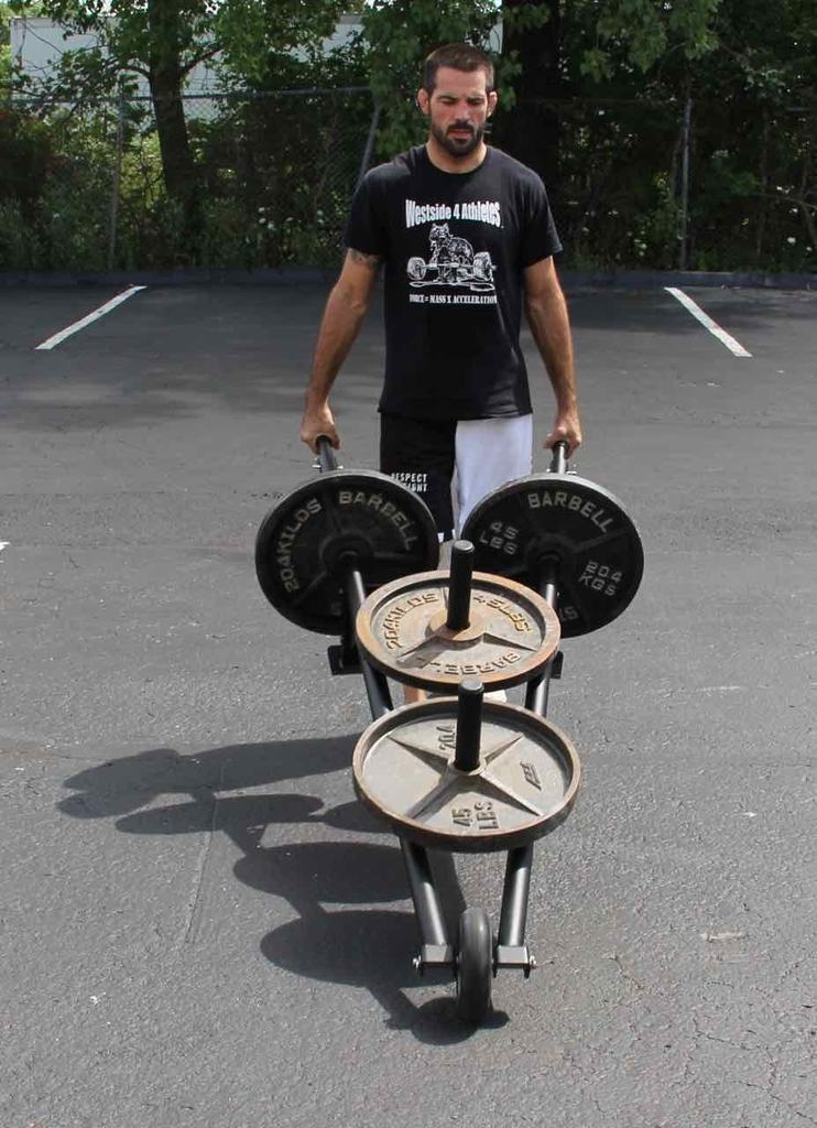 It may not be riding on the elliptical for 45 minutes watching Game of Thrones but strong people do conditioning too, and it actually helps them get stronger!    Image courtesy of Westside Barbell. War Wagon Barrow.
