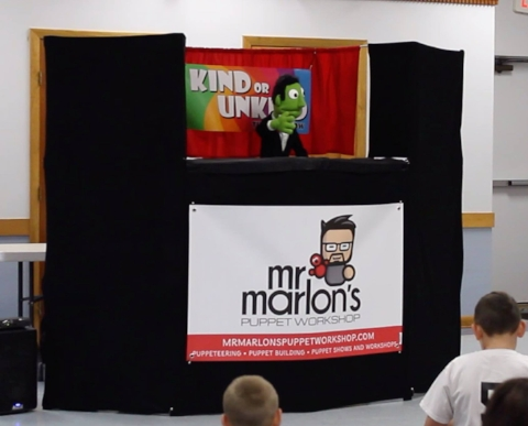 Performing a skit on kindness at a local Church.