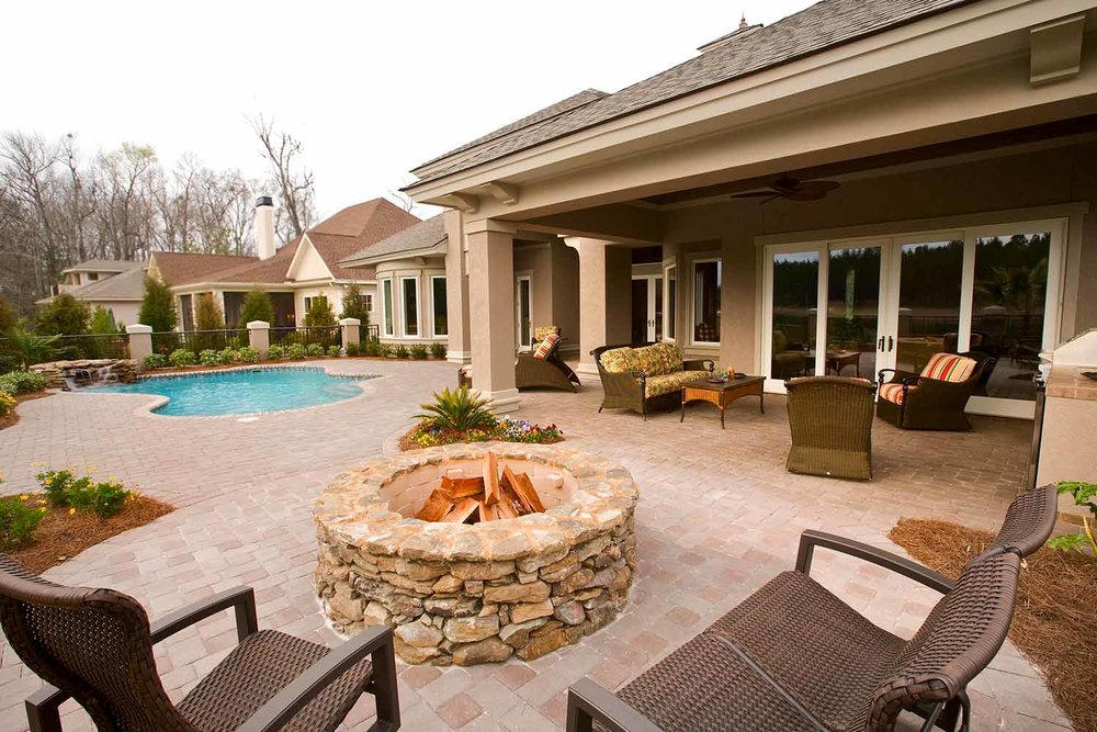 This space demonstrates flow perfectly with several outdoor rooms to enjoy; there's the pool area as well as a shaded conversation area. The firepit zone offers even more to enjoy- it's the perfect space for entertaining!