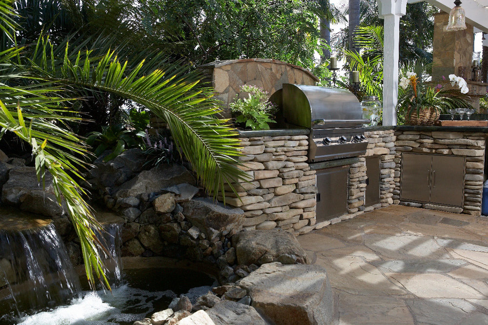 Another great example of flow at work: The lines of this water feature and outdoor kitchen coordinate to create a continuous flow from all of the adjoining outdoor living spaces. This outdoor living space was a custom design for a client that wanted a tropical feel for their outdoor living space.