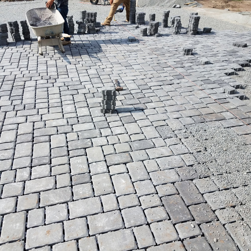 Our fabulous crew installing permeable pavers!