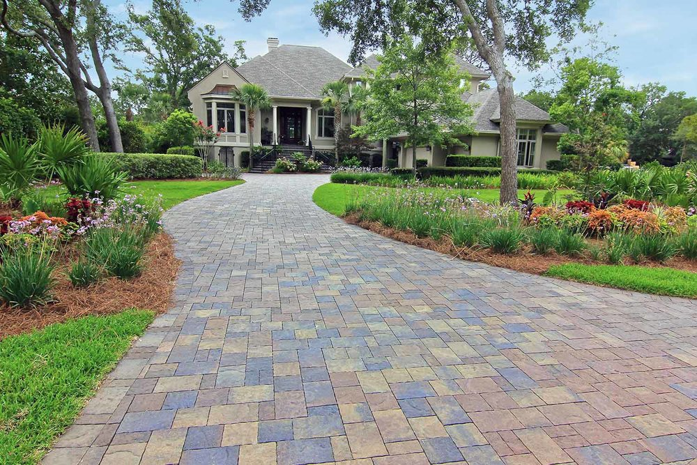 Sealed with a Wet Look Sealer, this vibrant Belgard, Paver Driveway is protected from UV Rays!