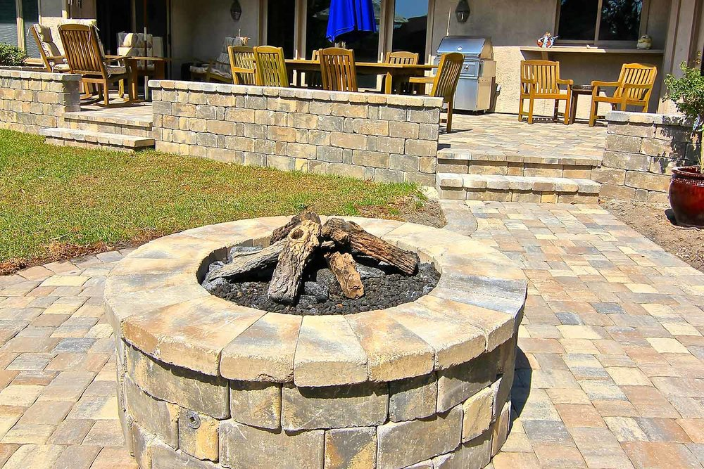 This Tremron, Stonegate Sierra, Gas burning fire pit is perfect for any Outdoor Living space! It's clean, simple and warm!