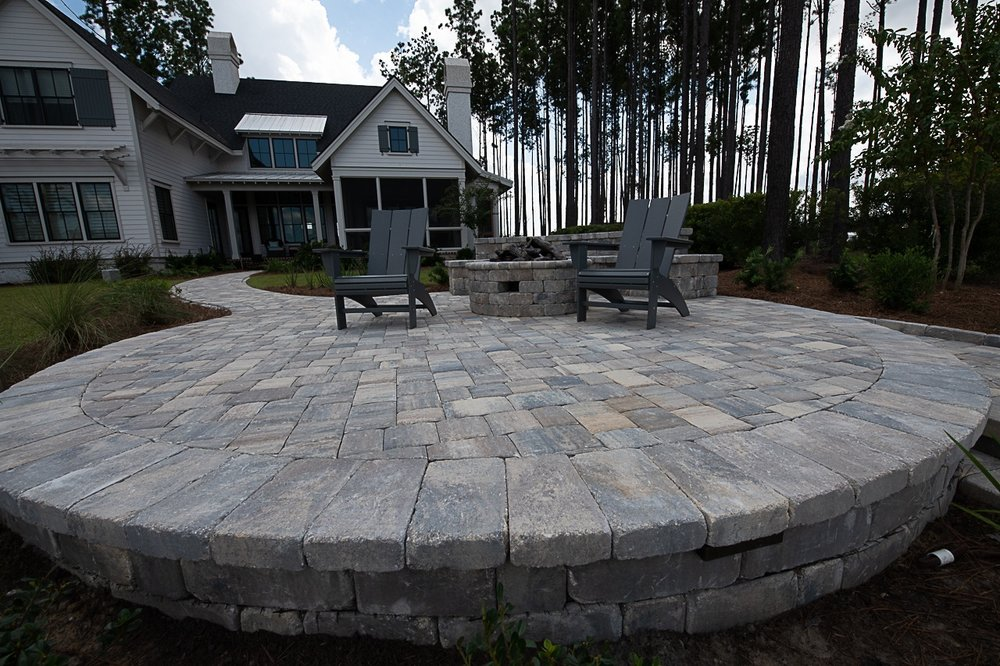 Choosing to use both tumbled and non tumbled brick pavers  in one project can create quite the look! Using tumbled wall block for seating walls and retaining walls can complement any paver patio project! Just look at this paver project above!