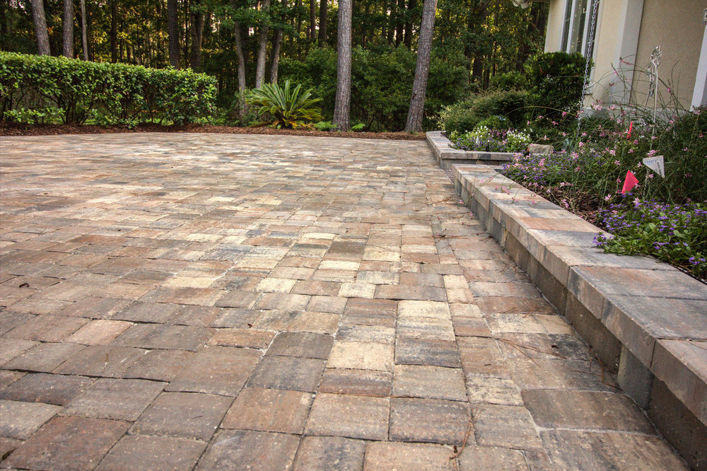 Using Retaining Wall Blocks around your Driveway, can help keep your Landscaping looking Fresh & New!