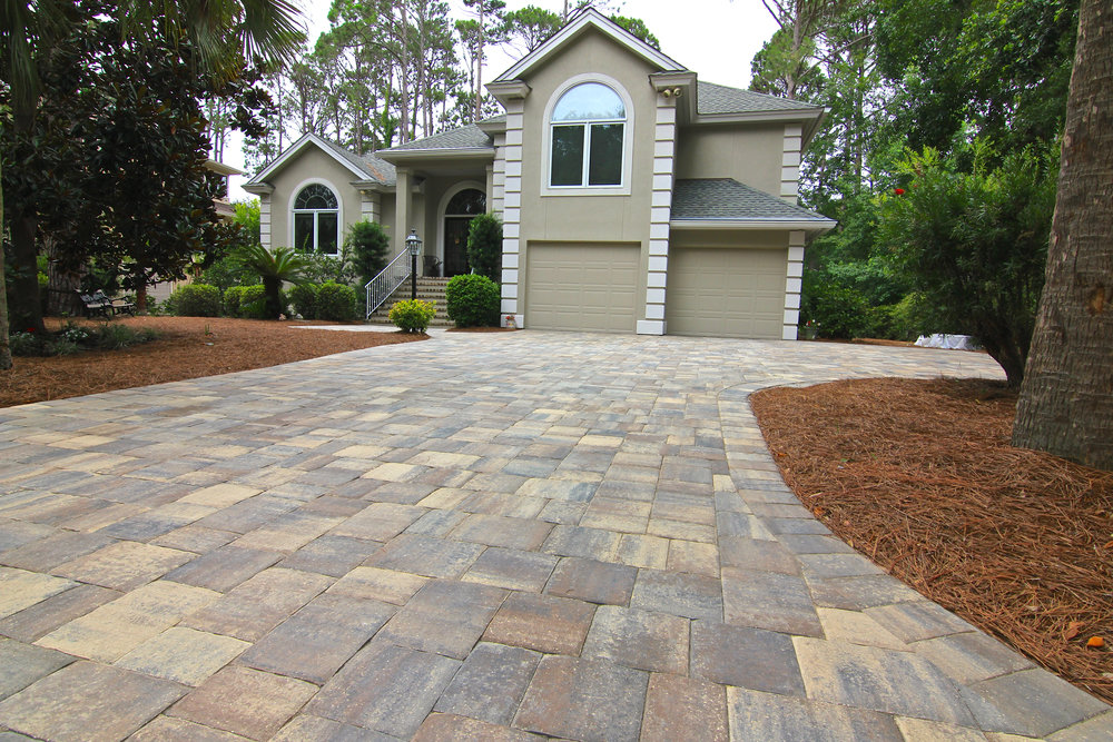 Looking to Make a Statement?    Using Large Format Pavers    - like these Tremron, Mega Olde Towne pavers ( color: Sierra ) can help make any driveway look bigger, more inviting and wider! With sizes ranging from; 6x9, 9x9 and 9x12 - these large interlocking pavers can compliment any home! The bigger the better!