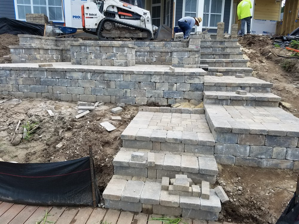 Raised Paver Patio Design With Wall Block