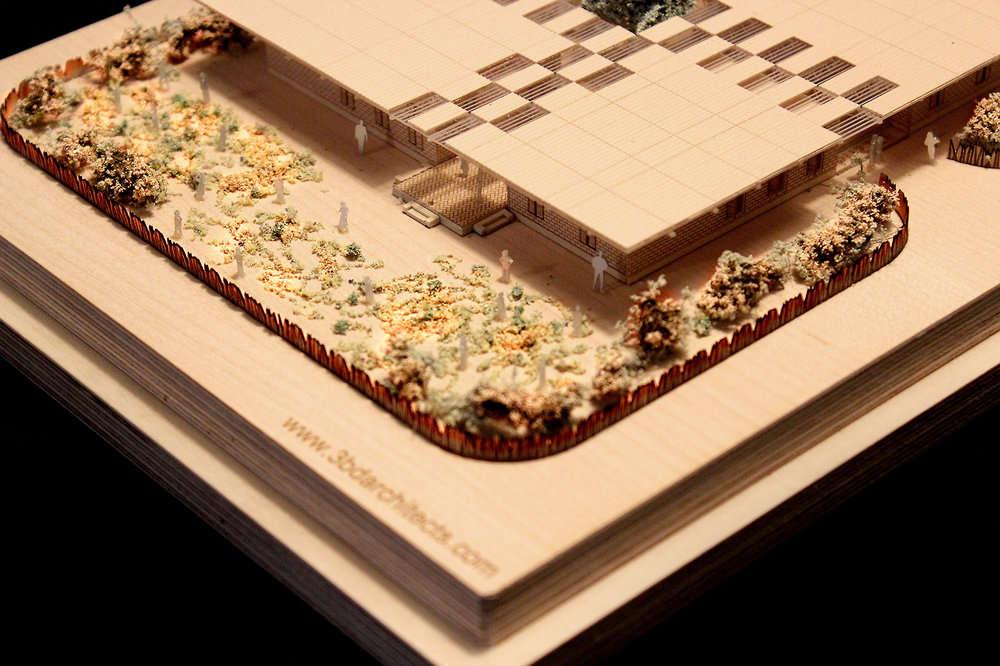 Closeup garden photograph of a 1 to 200 scale physical wood model of a Modular School Concept for in the Katanga region of the Democratic Republic of Congo by 3bd Architects.jpg