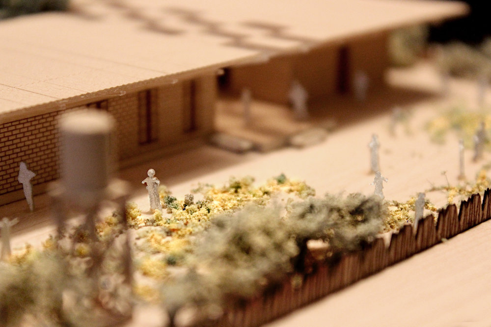 Garden photograph of a 1 to 200 scale physical wood model of a Modular School Concept for in the Katanga region of the Democratic Republic of Congo by 3bd Architects.jpg