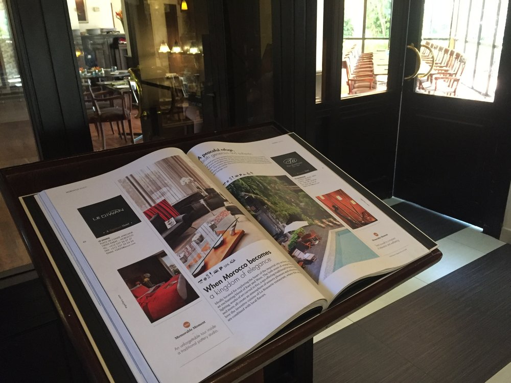 The door to the restaurant. There is a reminder (the book) of the Accor hotels brand and how Mgallery fits into the promised service
