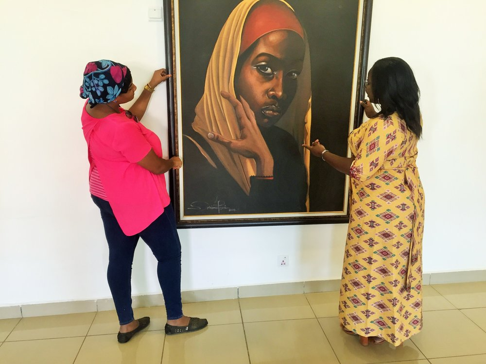 We were contemplating taking her home. The picture felt deep but no one around to explain the story behind the painting