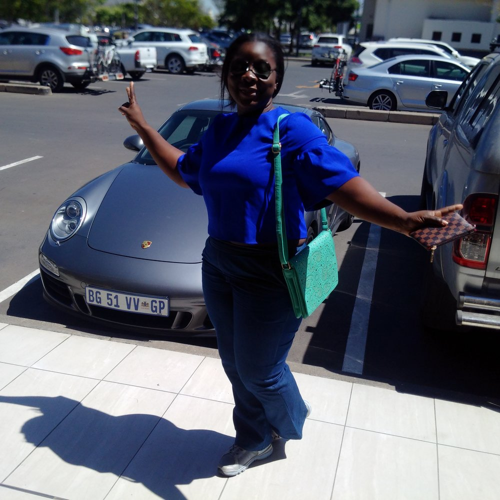 Tour of JohannesburgWaiting for my driver. Yes, I ride a Porsche when in SA. Chaiiii.....soon!.