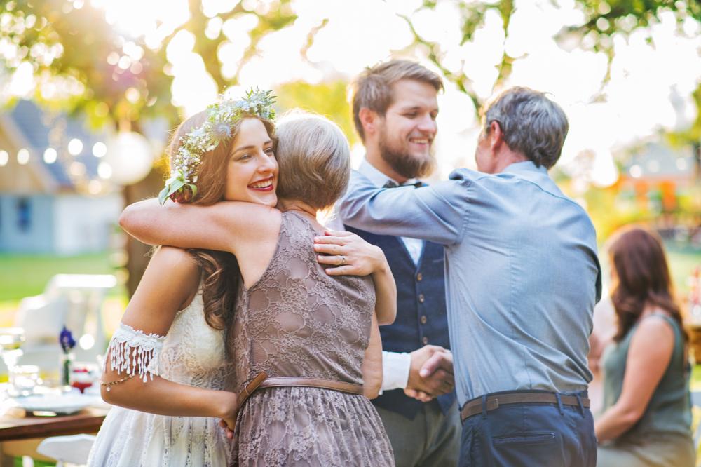 mother of the groom hugs the bride.jpg