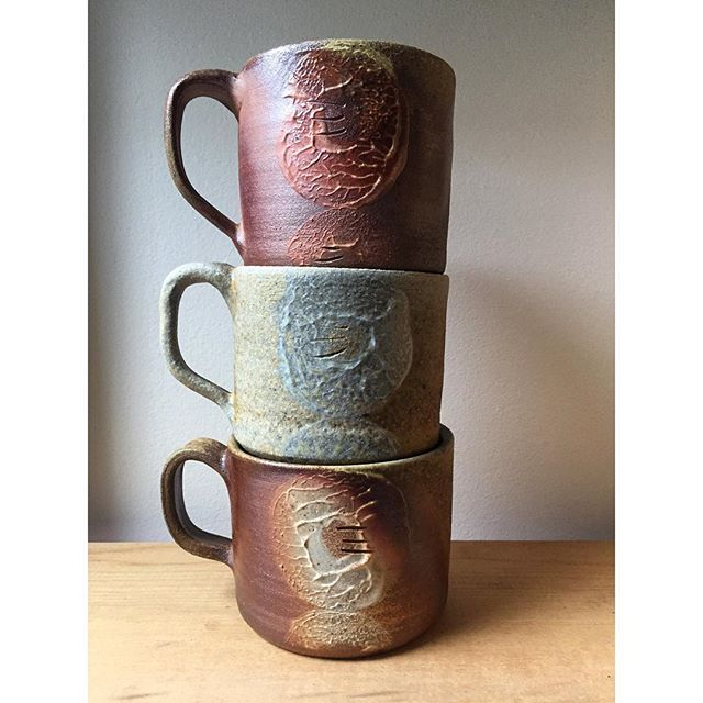 The slip decoration on these mugs is a little donuty... toasted, frosted, and cinnamon sugar . . . #ceramics #pottery #woodfiredpottery #woodfiredceramics #canadianceramics #keramik #handmadeincanada #hamont #mugshotmonday