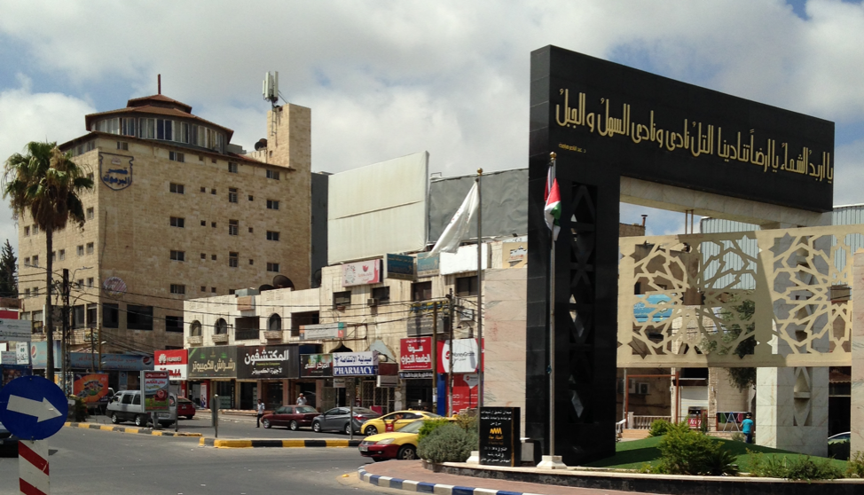"""""""University Circle,"""" was once mostly Jordanian college students, but is now home to thousands of Syrian family residences and workplaces."""