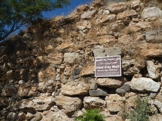 "Irbid's original bronze age walls, in the north of the city overlooking what is now a Palestinian ""camp."""