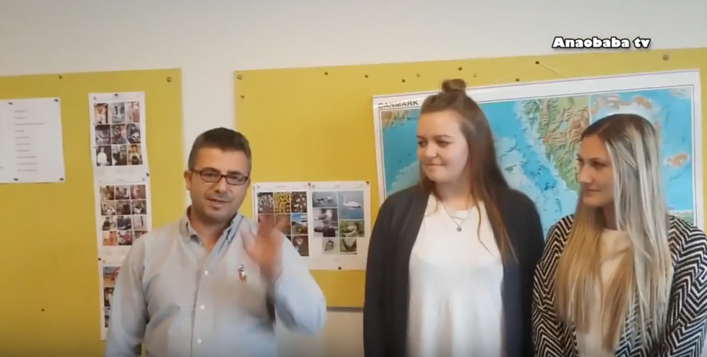 """The video shows Dilbrin standing with two Danish students who were interested in the project. Speaking to his children back in Syria, he says """"hi"""" and then introduces the students. One of them says """"hi"""" to his children, and Dilbrin tries to show that he is meeting people from many different countries, that he is learning a new language, and then shows his book from which he studies.  He told me that he would like to push his children and motivate them to study, and to give them hope that they will meet again one day and have a good school to attend. He promised his children to make a good video about the public schools in Denmark, which he has done  Click the photo to view the video."""