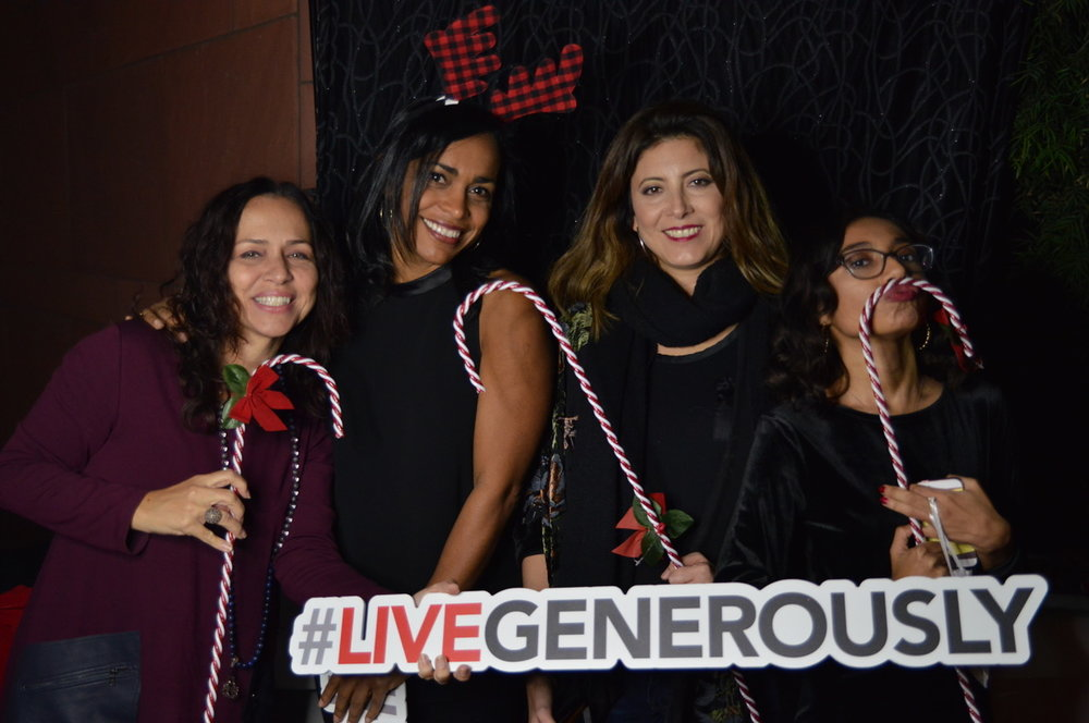 Maria Elena Fernandez of Vulture Magazine with her girl squad at the Launch of USLG holiday event -