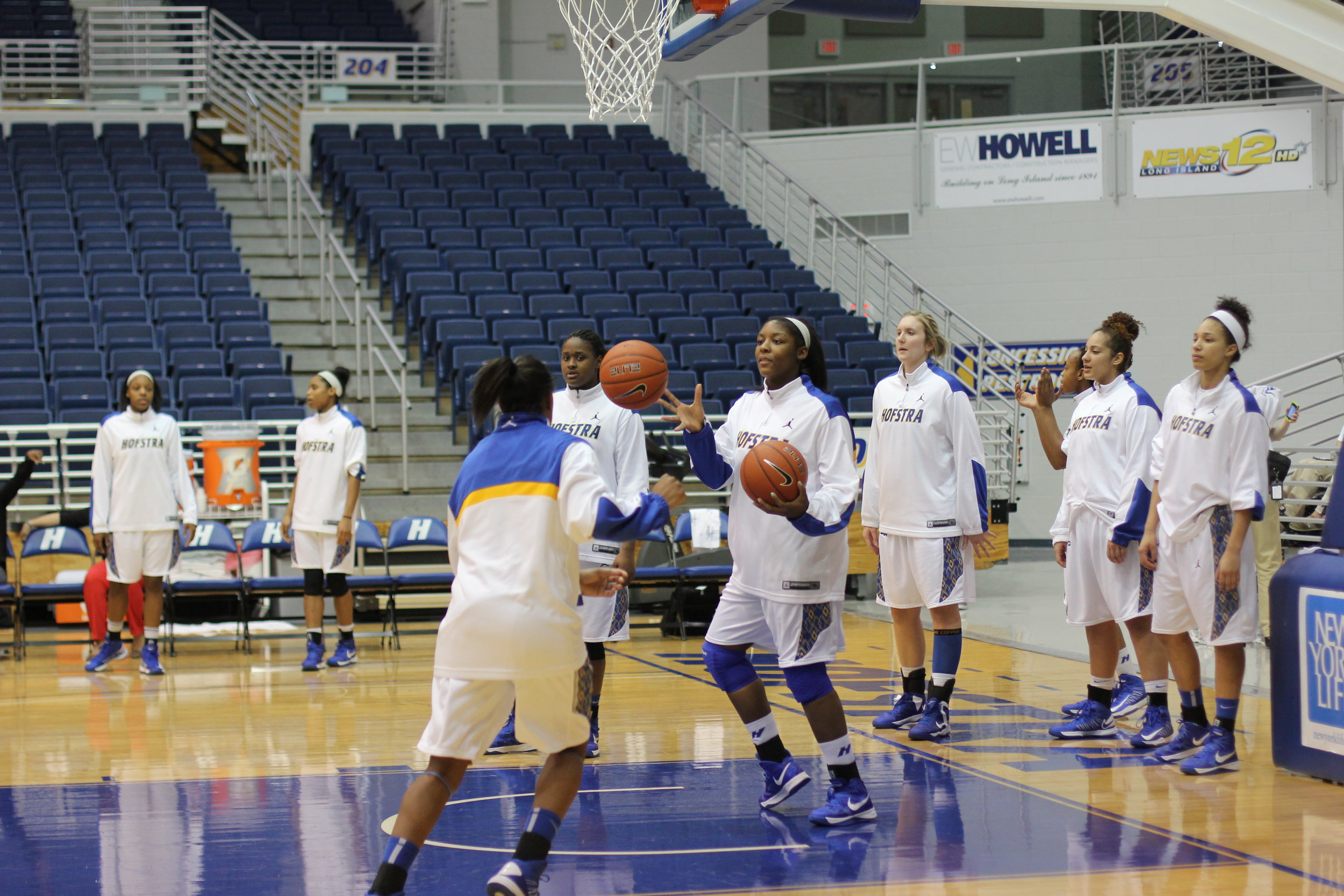 Hofstra women's basketball warming up before its Thursday night game against George Mason.