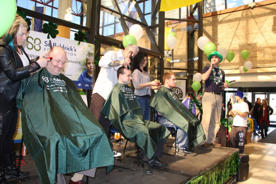 Three shavees donating to the St. Baldrick's foundation. Over $15,000 was donated so far. Photo by Cody Heintz.