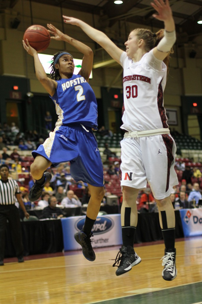Despite a hard fall on her head, Candace Bond (2) helped lead Hofstra to a 57-52 quarterfinal win over Northeastern.