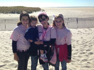 Dina Viskoc, a survivor walking at Jones Beach on Saturday, posed with her family, donning pink mustaches for breast cancer awareness. Photo by Briana Smith.