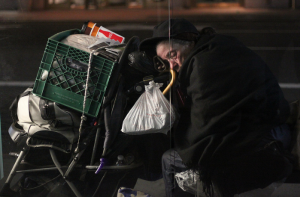 Photo by Alex Cassetti - Woman asleep on the sidewalk