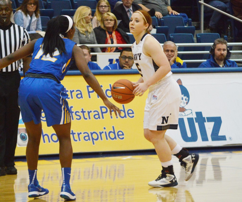 Jesse Saunders/The Chronicle Hofstra's Darius Faulk (12) awaits for the right time to steal the ball from Sarita Condie (5).
