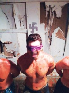 Photo sent to Sigma Pi's national organization allegedly shows student covered in hot sauce, blindfolded and kneeling in front of swastika.