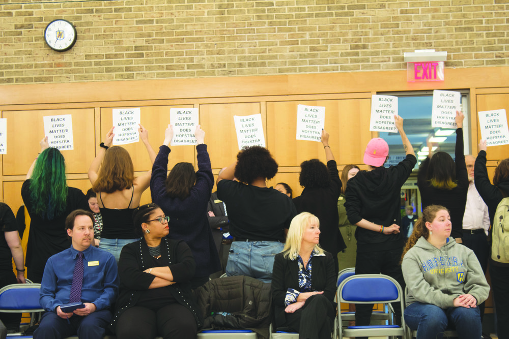 Students revisit the Jefferson statue debate during the meeting, holding up Black Lives Matter posters in protest.   Leo Brine/ Hofstra Chronicle