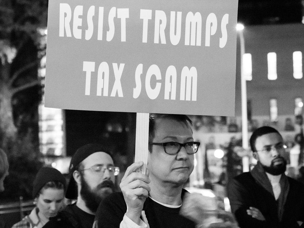 Citizens protest GOP tax bill. Photo courtesy of Wikimedia Commons.