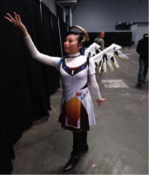 Jayne Linn cosplaying as Mercy from Overwatch.