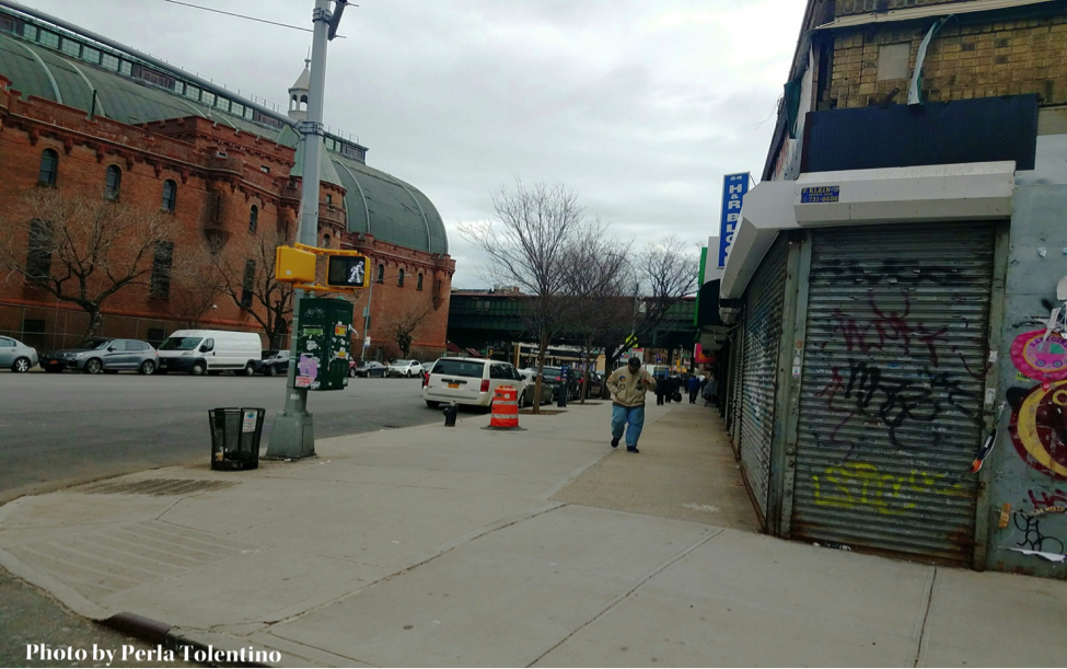 Businesses across the north side of the armory currently without a lease. The closed gate on the corner is the second market Patrick Lim was forced to close. Photo by Perla Tolentino.