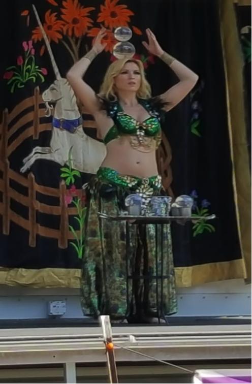 Anatolia Fire Goddess of the Mystical Muses performs an illusion act. Photo by Brittany Aufiero.