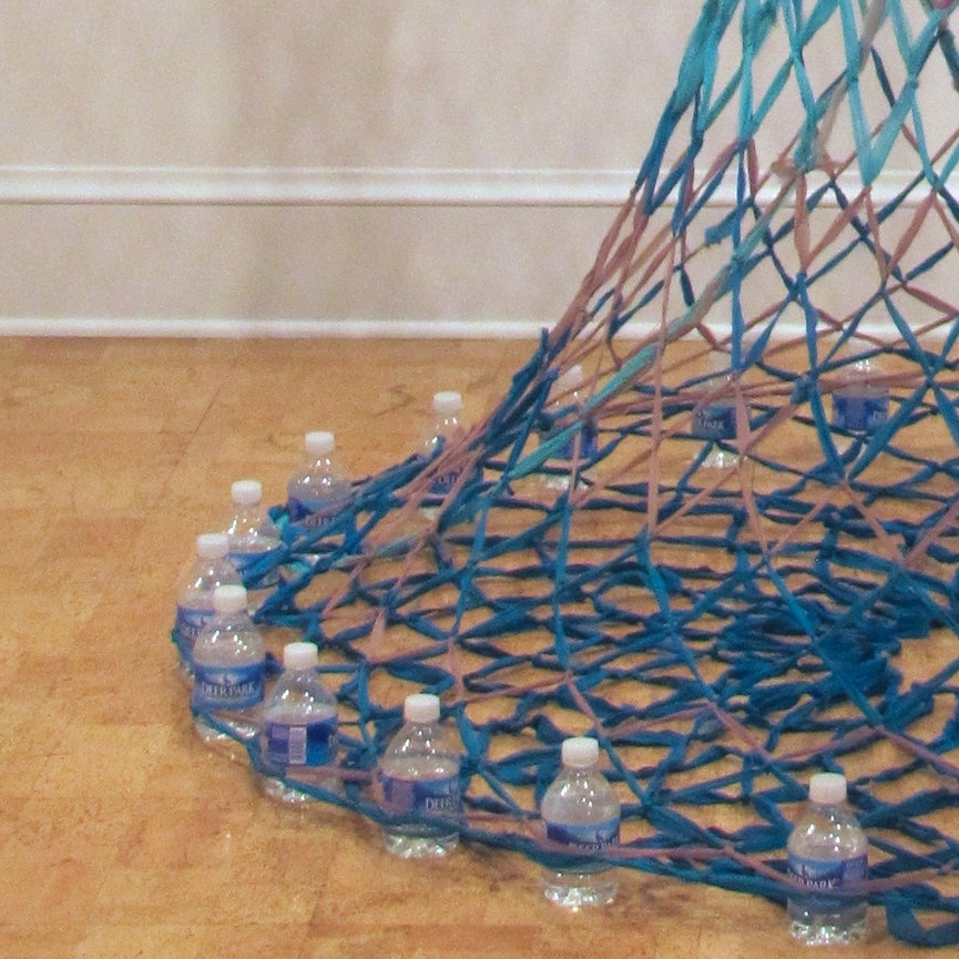 Blue Bycatch (2015)  - Netted strips of recycled materials, anchored by single-serving water bottles refilled with tap water.