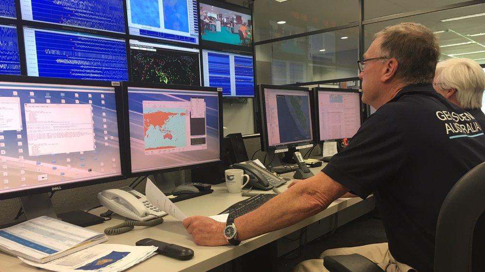 On-duty seismologists at the Geoscience Australia Earthquake Alert Centre, Canberra [Image courtesy of Geoscience Australia]