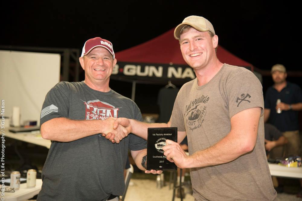 Receiving my plaque after a 1st place finish at a 3 Gun match.