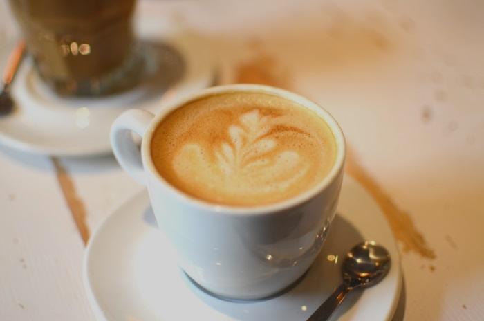 A cappuccino at  Bułkę przez Bibułkę