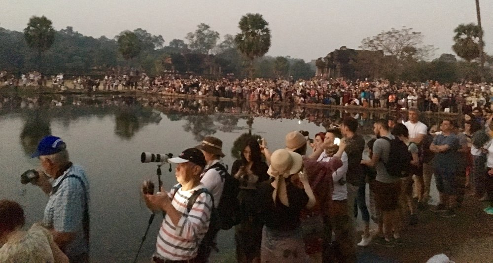 Tourist hordes at sunrise in front of Angkor Wat