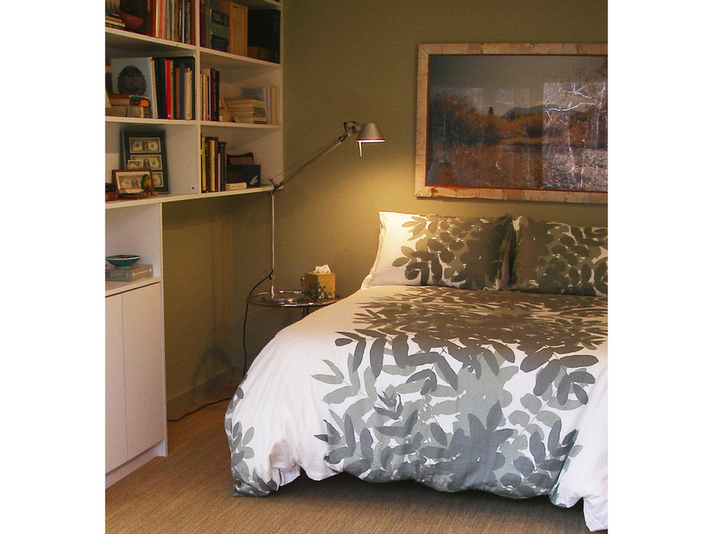 A Marimekko comforter adds a luxurious touch to a very comfortable bed.