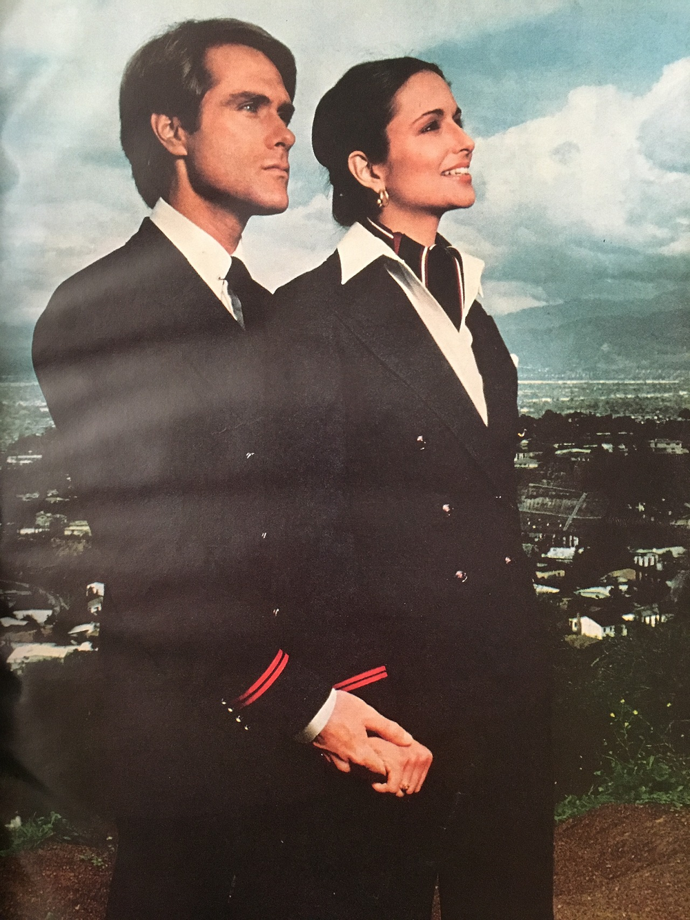 """""""TWA and Ralph Lauren. The Professionals. In Flight. In Fashion."""" TWA decided to approach Ralph Lauren for their new flight attendant uniforms in 1978. These uniforms ushered in a new era of polished professionalism as opposed to the colorful and playful Valentino uniforms from the'60s through the mid'70s. Vogue. June 1978."""