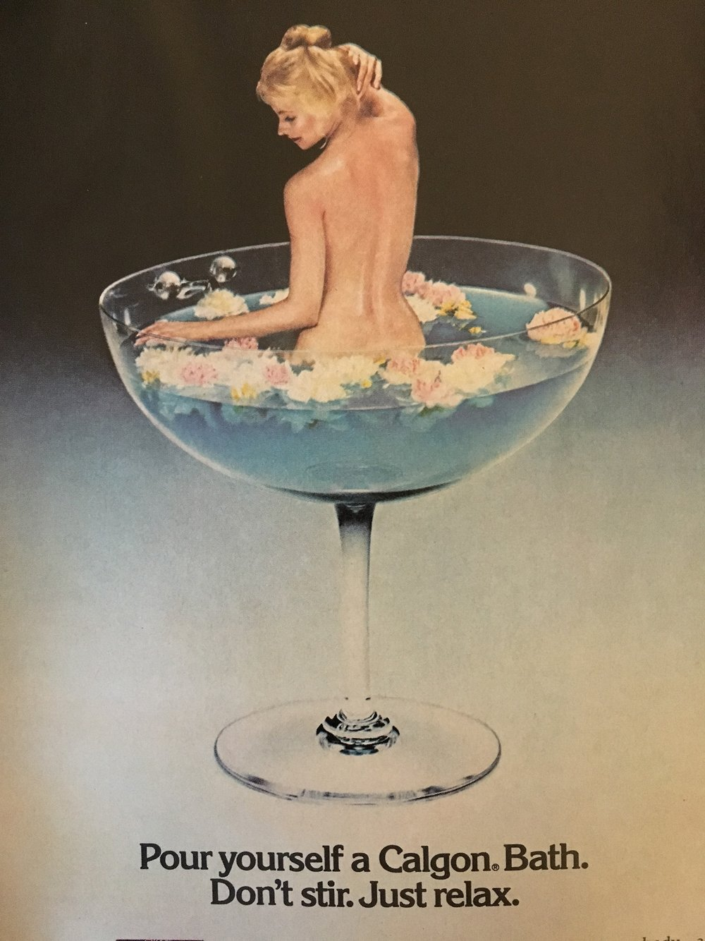 Pour yourself a Calgon Bath. Don't stir. Just relax. Mademoiselle. May 1976. Around this era, you started to see a LOT of couples resorts that had those champagne bathtubs. I think this ad for Calgon may have been inspired by those.