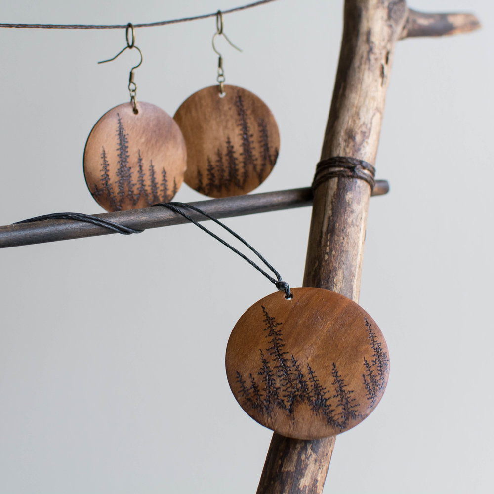 JEWELRY & ACCESSORIES - Our boutique is carries ethically-imported purses, yoga bags and cross-body bags. We also carry a variety of jewelry, including sterling silver earrings, gemstones and aromatherapy bracelets and pendants. We also carry locally-made artisan pieces from Burnt Timber (pictured).