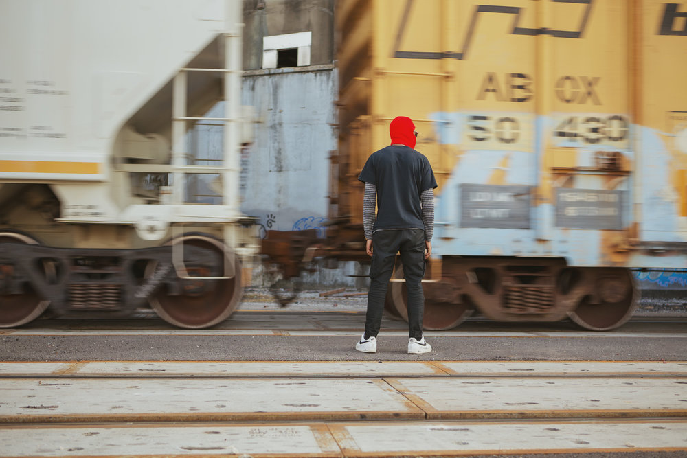 Image of a man watching a train passing by
