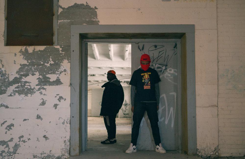 Image of two men posing in a doorway