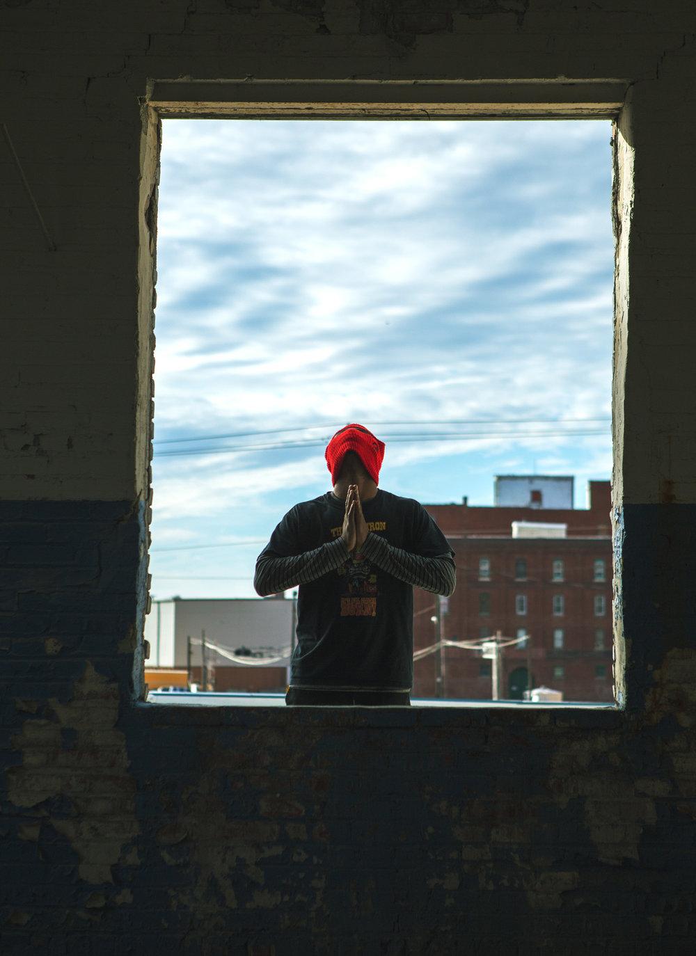 Image of man looking up and praying