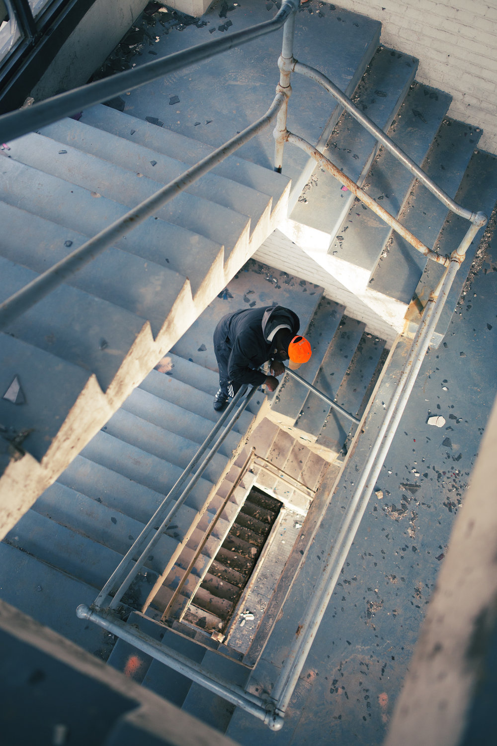 Image of man looking down the abandoned building staircase
