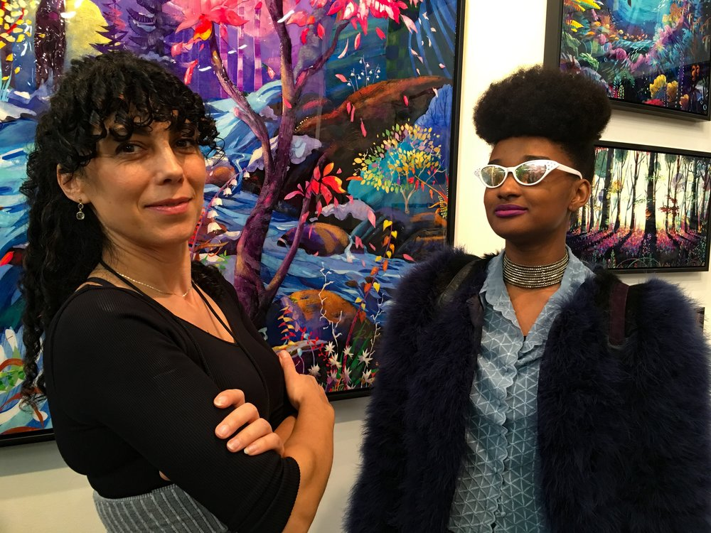 The beautiful CEO of FYID NYC, Imani Jones(Right), was seen with the co-founder of Art Brand Studio, Redina Teli(Left) posing in front of her amazing art-piece that is colorful, bold and unapologetic in its own way.