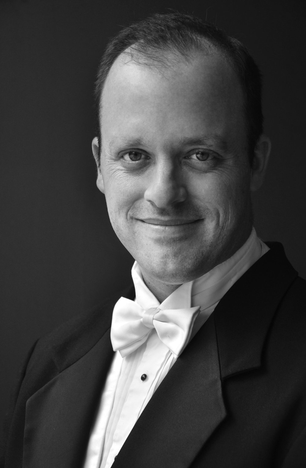Andrew Crane, President Elect - Andrew Crane was named Associate Professor of Choral Conducting and conductor of the Brigham Young University Singers in 2015. Previous to this appointment, he served for four years as Director of Choral Activities at East Carolina University, and six years in the same position at California State University, San Bernardino. He is also the former choral director at Provo High School.Choirs under his direction have appeared by invitation at multiple conferences of the American Choral Directors Association and National Association for Music Education; and have won top prizes in international competitions. In 2015, he led the East Carolina University Chamber Singers to a first place finish in the 13th Maribor (Slovenia) International Choral Competition Gallus, the only American choir to win in the history of the contest.Since coming to BYU, he has conducted the University Singers in joint concerts with the King's Singers, and also prepared the choir for performances of Handel's Messiah with conductor Nigel Short and the British vocal ensemble Tenebrae. In February 2017, BYU Singers will appear in an invited performance at the state convention of the Utah Music Educators Association. Additionally, Dr. Crane enjoys a career as a professional solo and ensemble tenor, having appeared with such groups as the Los Angeles Bach Festival, Santa Fe Desert Chorale, Yale Choral Artists, Vox Humana, Spire Chamber Ensemble, Tennessee Chamber Chorus, Lansing Symphony Orchestra, North Carolina Master Chorale, Carnegie Hall Festival Chorus, and others.Dr. Crane is active as a conductor of honor choirs, clinician, guest lecturer, and accompanist. Additionally, he serves as editor of the Andrew Crane Choral Series through Walton Music; and as the College and University Repertoire and Resources chair for Utah ACDA. His degrees include the BM in Music Education and MM in Choral Conducting from Brigham Young University, and the Doctor of Musical Arts from Michigan State University.
